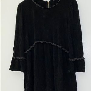 Black babydoll top with bell sleeves